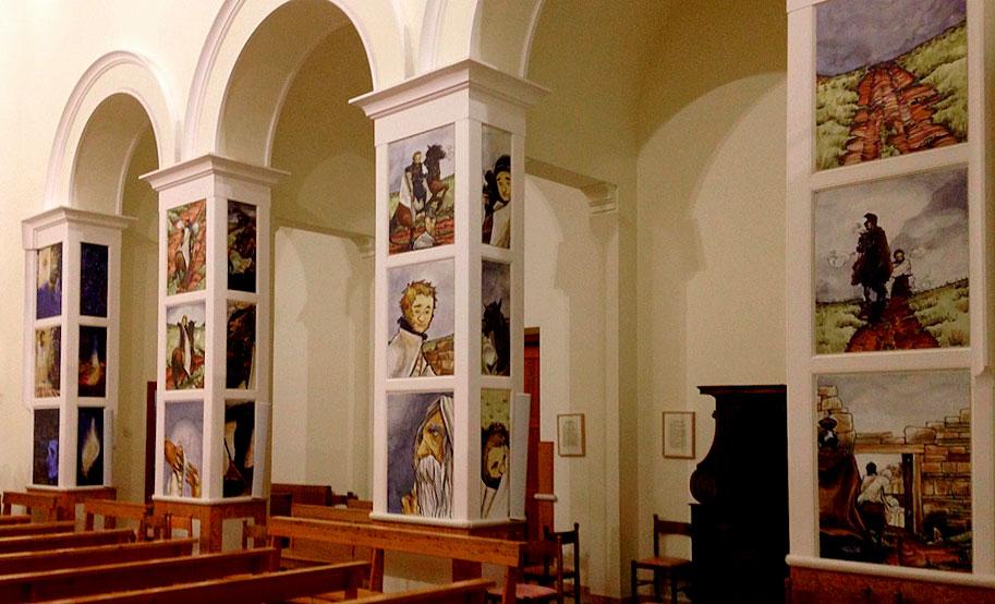 Le colonne con i fumetti sulla storia di San Martino